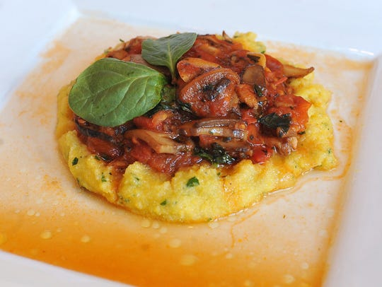 Dish:  Polenta with mushrooms made by owner and chef