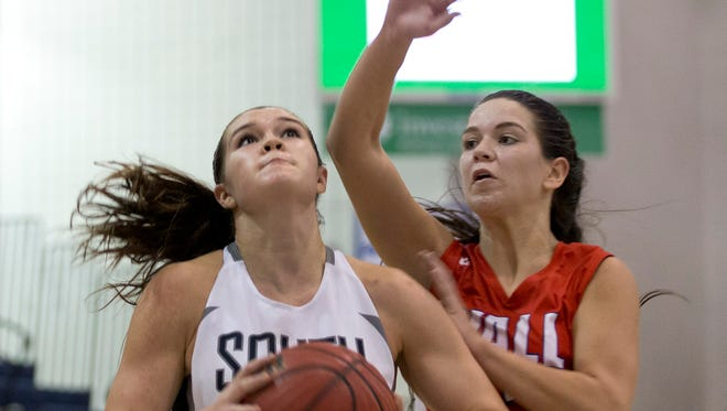 Middletown South's Stephanie Karcz goes up with shot as Wall's Nicole Callamaras tries to guard her. Wall Girls Basketball vs Middletown South in WOBM Classic Quarterfinal