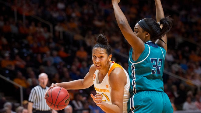 Tennessee's Mercedes Russell is defended by UNC Wilmington's Rebekah Banks on Thursday, December 29, 2016.