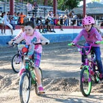 Girls race in the BMX Races conducted Thursday by the Yerington Lions Club.