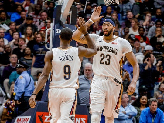 Anthony Davis celebrates with Rajon Rondo during the