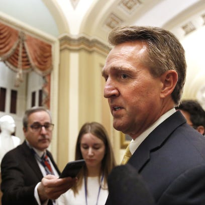 Sen. Jeff Flake chats with reporters on Capitol Hill