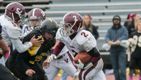 Valhalla's Michael Ferrara runs for a touchdown during