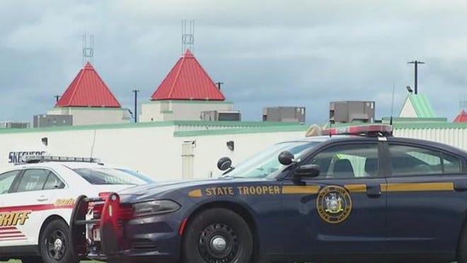 Law enforcement vehicles are seen Tuesday near Waterloo Premium Outlets in Junius.