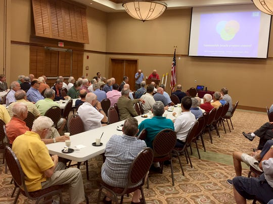 About 100 members of the Pelican Bay Foundation's men's coffee group gathered Tuesday morning for a presentation on pressure equalizing modules, which are designed to slow or stop beach erosion.