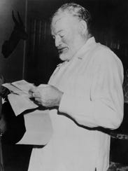 Dated 1952: American writer Ernest Hemingway learning