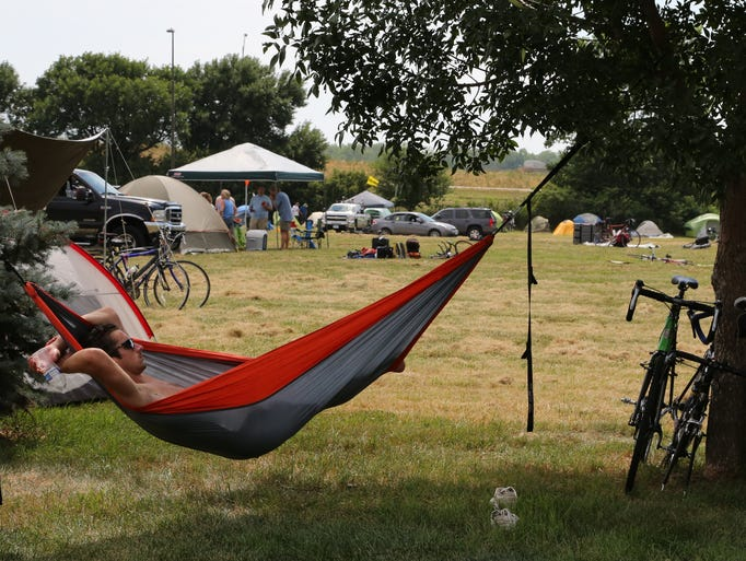 Lucas Hartleben of Minneapolis, MN, hangs out in the hammock Saturday after setting up camp.