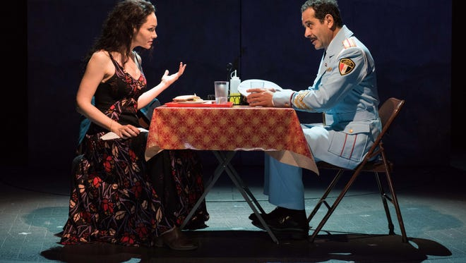 """Katrina Lenk and Tony Shalhoub reach an understanding in """"The Band's Visit."""" Lenk and Shalhoub, a Green Bay native, were both nominated for Tony Awards Tuesday for their performance in the musical."""