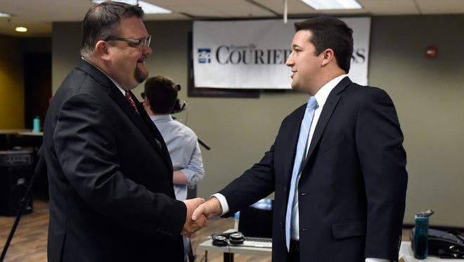 Indiana House district 77 candidates Johnny Kincaid, left, and Ryan Hatfield shake hands before a debate at the Evansville Courier & Press Wednesday.