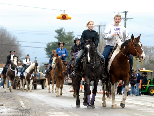 Loren Schil and Jessica Radatz for Zacharias Farms ride horses Sunday in the parade at Suckerfest in Adair. The annual festival helps raise money for the Salvation Army.