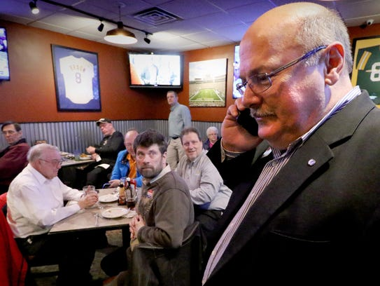Steve Olson checks his voice mail for any news while