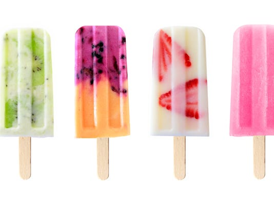Mixed fruit popsicles isolated on white