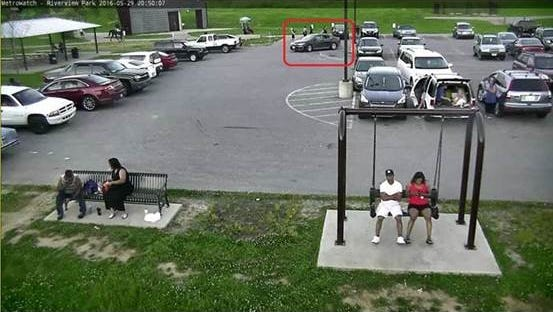 LMPD said a black passenger car, pictured here, was used by suspects in a fatal shooting at Riverview Park. The shooting late Sunday came as several people were relaxing in the park during the holiday weekend.