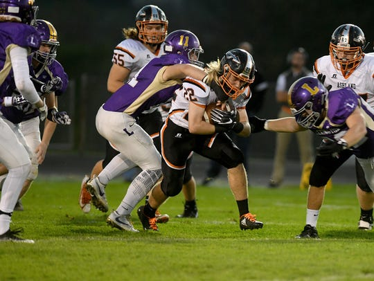 Ashland's Owen Reef is grabbed by Lexington's Kaden Berry last season at Lexington High School.