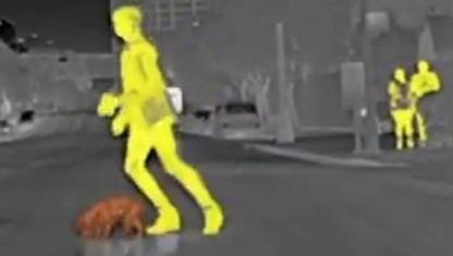 The infrared image of a woman and a dog as it appeared in the BMW