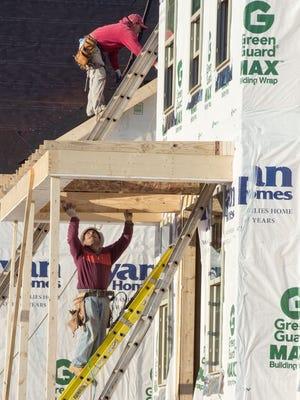 Work on a new home in Ashburn, Va.