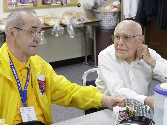 Lloyd Larsen, left, and Edgar Kuhlow talk about their experiences as POWs at the Sheboygan Falls senior center in Falls.