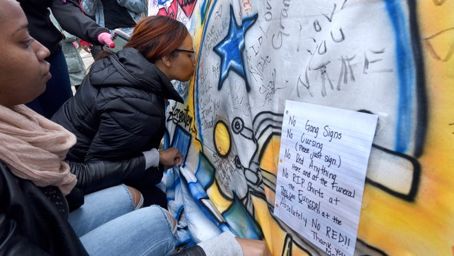 After her son Nate Plummer Jr. was gunned down at age 13 in East Camden in January, Taisha Mercado kisses a sheet that was airbrushed in his memory. On it, she posted warnings for anyone attending the funeral not to make gang signs or wear gang colors.