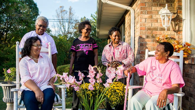 [Left to right] Breast cancer survivors Barbara Allen, Ernestine Rawls, Sharon Hadden, Marion Thomas, and Karol Pittman joke around outside the home of Barbara Allen Monday before the start of a Sister2Sister meeting to plan their annual fundraiser fashion show.