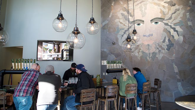Patrons enjoy fresh brews inside the Green Mansion, an expansion of Green Man Brewery on Buxton Street that opened last year.