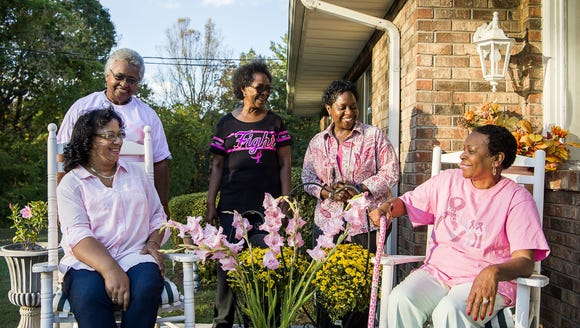 From left, breast cancer survivors Barbara Allen, Ernestine