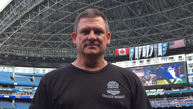 Tigers batting practice pitcher Ed Hodge, a former police officer, wore this T-shirt honoring law enforcement Saturday in Toronto.