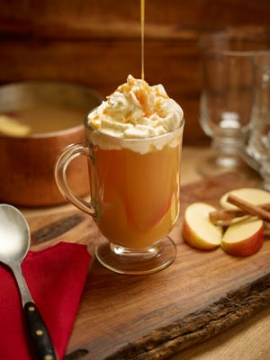 This Nov. 18, 2016 photo provided by The Culinary Institute of America shows a hot cider cocktail in Hyde Park, N.Y. This drink is from a recipe by the CIA.