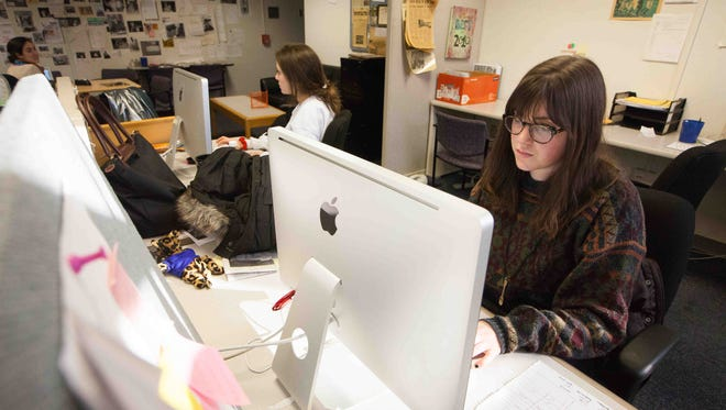 University of Delaware students Hannah Griffin, left, and Krista Adams work at the student newspaper, The Review, on Feb. 23. Students are considering converting completely to a digital publication model.