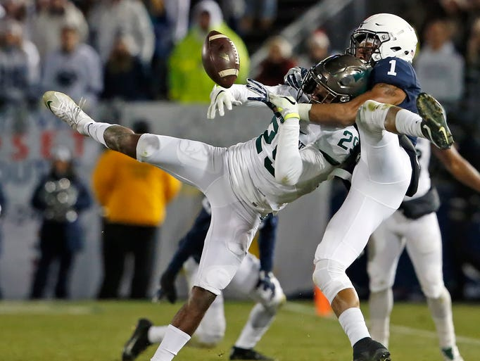 Penn State's Christian Campbell (1) breaks up a pass
