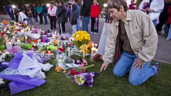 Locals attend a memorial after the Tuscon shooting.