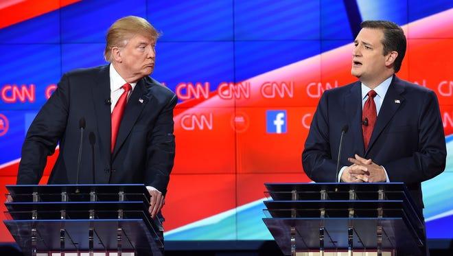 Donald Trump looks on as Ted Cruz speaks during a break in the Republican debate on Dec. 15, 2015, in Las Vegas.
