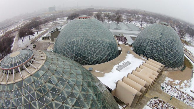 In this Feb. 2016 photo, the Mitchell Park Domes at the Mitchell Park Conservatory are closed as county officials launch a repair job to protect the public from falling pieces.