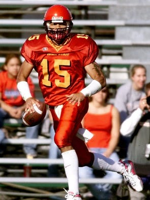 Iowa State quarterback Seneca Wallace looks down field for the receiver in a game against Kansas State played in Ames.