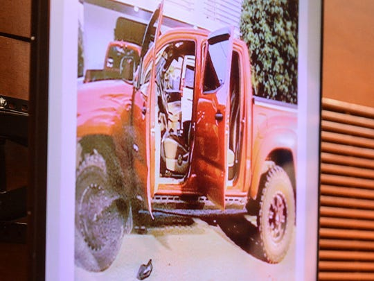 An image of a red pickup truck is displayed on screen for jurors during the fourth day in the murder trial of former Guam police officer, Mark Torre Jr., at the Superior Court of Guam on Thursday, Feb. 2, 2017. The image of the vehicle was taken during the investigation of the July 2015 shooting death of Guam Police Department Sgt. Elbert Piolo. Torre is currently on trial in connection to the fatal shooting.
