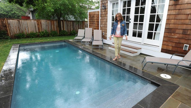 Lori Bloxom and her husband, John, own a rental home in Rehoboth Beach with a pool. If a proposal by Rehoboth's mayor took effect, they could not allow their renters to use the pool in season, and would need to lock it away under cover.