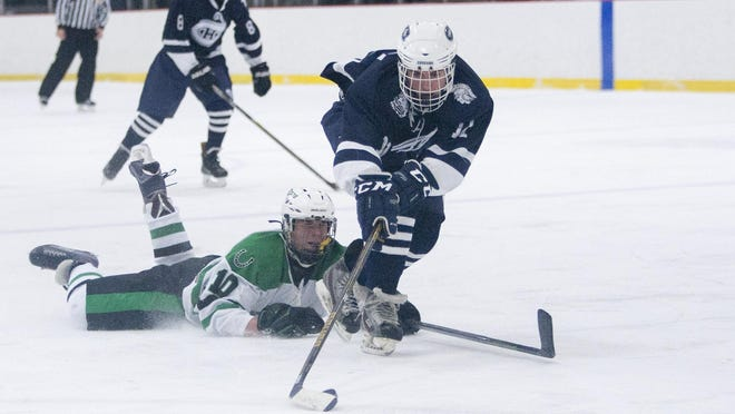 Chatham's Sam Ortolani heads up ice with the puck despite the efforts of Kinnelon's Sean Gould during third period of Saturday's game.