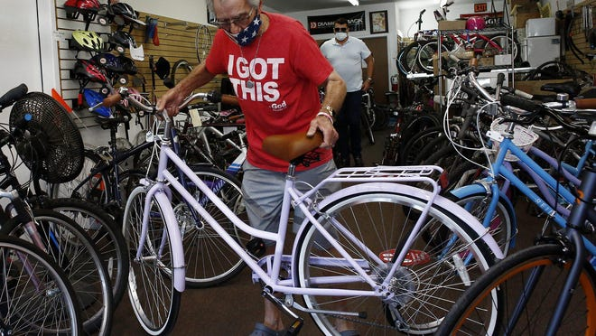 Dandy Bikes owner Gary Stivers says his Clintonville store has fewer new and refurbished bikes on the sales floor than usual and has about 20 bikes awaiting repairs.