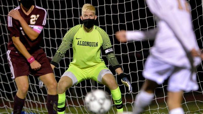 Algonquin senior goalie Brendan McCarthy prepares to make a save during Thursday night´s game against Shrewsbury at Algonquin Regional.