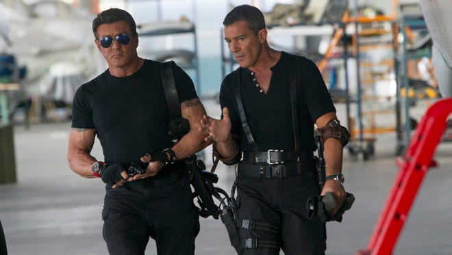 """Sylvester Stallone, left, and Antonio Banderas in a scene from """"Expendables 3."""""""