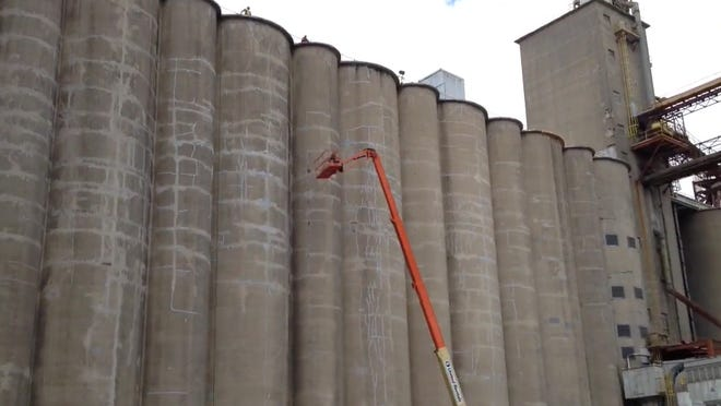 Grain bins at ADM's Beech Grove plant serve both new and old mills.