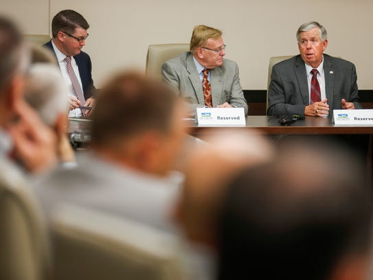 Missouri Governor Mike Parson, right, speaks during