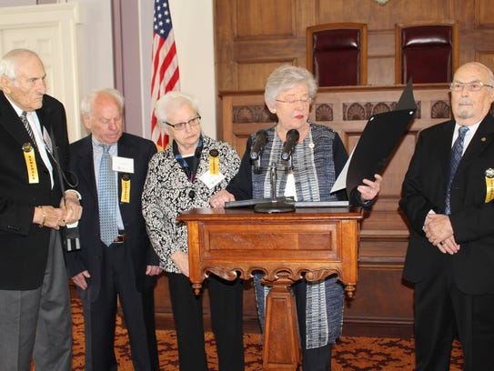 Gov. Kay Ivey reads a proclamation at Tuesday's Holocaust