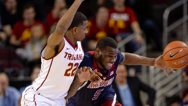 Arizona guard Kadeem Allen (5) attempts to get by Southern California guard De'Anthony Melton (22) during the first half of an NCAA college basketball game, Thursday, Jan. 19, 2017, in Los Angeles.