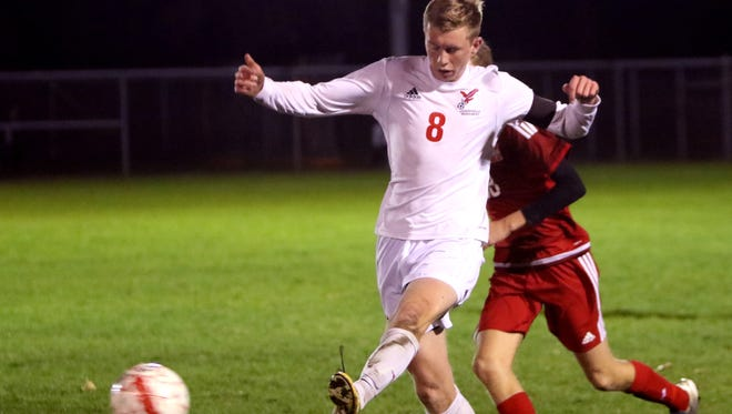 Arrowhead's Jake Stemper sends the ball away from a Sussex Hamilton player during WIAA sectional semifinal play at Arrowhead High School on Oct. 26.