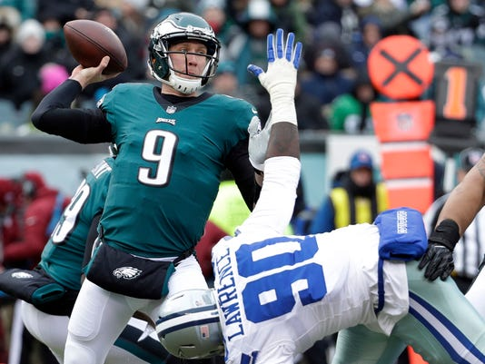 FILE - In this Dec. 31, 2017, file photo, Philadelphia Eagles' Nick Foles (9) throws a pass over Dallas Cowboys' DeMarcus Lawrence (90) during the first half of an NFL football game in Philadelphia. Foles will be the 14th quarterback to start in a Super Bowl after not starting the regular season opener for his team. (AP Photo/Chris Szagola, File)