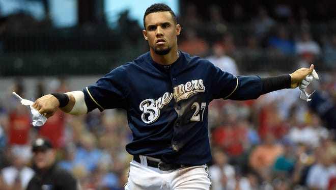 Milwaukee Brewers center fielder Carlos Gomez (27) rips apart his batting glove after striking out in the fifth inning during the game against the St. Louis Cardinals at Miller Park.