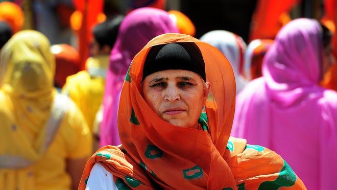 Sukhbir Kaur prepares for the Nagar Kirtan parade Saturday, June 20, at the Dasmesh Darbar Sikh Temple in Salem. The temple organized the parade to tribute Sri Guru Arjan Dev Ji Sahib's Martyrdom Day.