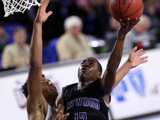 Haywood's Jalen Benton shoots against CPA's Braxton Blackwell in the second half Friday in the Class AA state semifinals at MTSU. Haywood won 60-54.