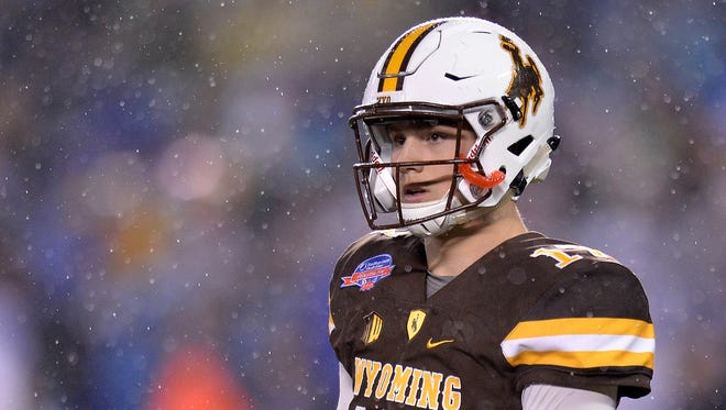 Wyoming Cowboys quarterback Josh Allen (17) looks on during the first quarter against the Brigham Young Cougars at Qualcomm Stadium.