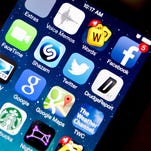 A view of apps on an iPhone 5S smartphone.
